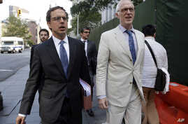 Carmine Boccuzzi, foreground left, a lawyer representing Argentina, leaves Federal court after a hearing, in New York, Aug. 21, 2014.
