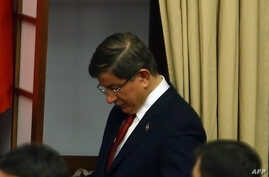 Turkey's outgoing Prime Minister Ahmet Davutoglu votes during discussions on the ruling AK Party's proposal regarding the amendment of the immunity on May 18, 2016 at the Turkish Parliament in Ankara.