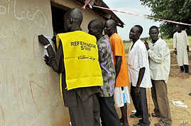 Residents of the remote south central Southern Sudan village of Nyal line up to register their names at a local school being used as a voter registration office, 15 Nov 2010.