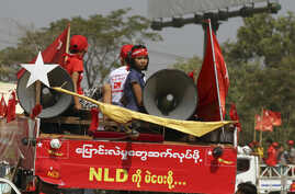 "Supporters of Myanmar ruling National League for Democracy party ride on a truck displaying banner that reads: ""To continue change, let's vote NLD"" during a campaign for the upcoming by-election, March 19, 2017, in the outskirts of Yangon, Myanmar."