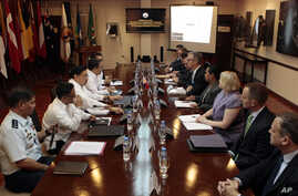 Philippine and U.S. negotiators discussing U.S. troop presence in the Philippines are seen meeting at the Department of National Defense headquarters in Quezon city, north of Manila, in this August 14, 2013, file photo.