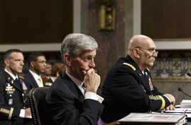 Army Secretary John M. McHugh, left, and Army Chief of Staff Gen Raymond Odierno update members of the Senate Armed Services Committee about the deadly shooting rampage by a soldier yesterday at Fort Hood in Texas, April 3, 2014.