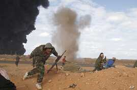 Rebels run for cover during clashes with pro-Gaddafi forces between Ras Lanuf and Ben Jawad, March 9, 2011