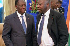 A file photo of Ivory Coast's President Laurent Gbagbo and former PM Alassane Outtara speaking after attending a meeting on 21 Sep 2010 in Ouagadougou