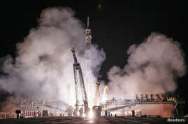 The Soyuz TMA-14M spacecraft carrying the International Space Station crew of Barry Wilmore of the U.S., and Alexander Samokutyaev and Elena Serova of Russia blasts off from the launch pad at the Baikonur cosmodrome, September 26, 2014.
