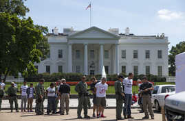 Demonstrators are arrested outside White House during protest on immigration reform, Washington, Aug. 28, 2014.