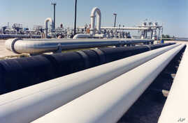 An undated photo provided by the Energy Department shows crude oil pipelines near Freeport, Texas.