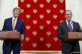 Russian Foreign Minister Sergei Lavrov, right, and U.S. Secretary of State John Kerry attend a news conference at the Kremlin in Moscow, Russia, March 24, 2016.