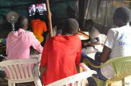 Displaced South Sudanese gather in front of a television in UNMISS's Tongping camp in Juba to watch sport and take their minds off their plight.