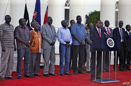 This picture released by the Kenya presidential service shows Kenyan President Uhuru Kenyatta speaking during a press conference with the seven detainees released to his custody by South Sudan President after addressing a press conference at State Ho