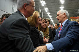 U.S. Vice President Mike Pence greets supporters following a speech about the American Health Care Act during a visit to the Harshaw-Trane Parts and Distribution Center in Louisville, Kentucky, March 11, 2017.