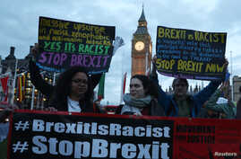 Demonstrators hold placards during a protest in favor of amendments to the Brexit Bill outside the Houses of Parliament, in London, Britain, March 13, 2017.