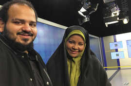 In this undated photo provided by Iranian state television's English-language service, Press TV, American-born news anchor Marzieh Hashemi, right, smiles as she stands with her son in Tehran, Iran.
