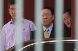 North Korean Ambassador to Malaysia, Kang Chol, center, prepares to get in a car at the embassy in Kuala Lumpur, Malaysia, March 6, 2017. Malaysia is expelling Chol over the poisoning of Kim Jong Nam, the estranged half-brother of North Korea's leade