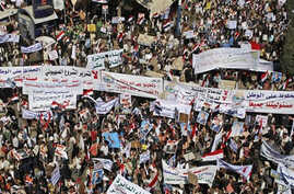 Supporters of Yemeni President Ali Abdullah Saleh hold banners and raise his portraits during a rally in support of Saleh and his government in Sanaa,Yemen, Thursday, Feb. 3, 2011.
