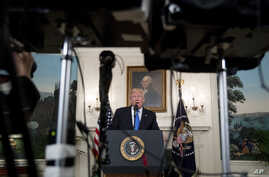 President Donald Trump speaks in the Diplomatic Room of the White House in Washington, June 14, 2017, about the shooting in Alexandria, Va.