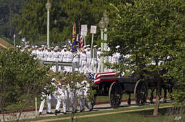 A horse-drawn caisson carries the casket containing the remains of Sen. John McCain, R-Ariz., to his burial sight at the United States Naval Academy Cemetery in Annapolis Md., Sunday, Sept. 2, 2018. McCain died Aug. 25 from brain cancer at age 81.