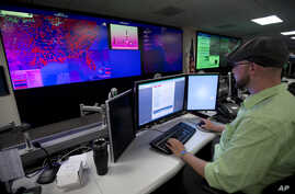 FILE - A specialist works at the National Cybersecurity and Communications Integration Center in Arlington, Va., Sept. 9, 2014.