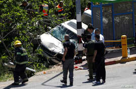 Israeli security forces and emergency personnel inspect the scene of a Palestinian car ramming attack near the Jewish settlement of Ofra near the West Bank city of Ramallah April 6, 2017.
