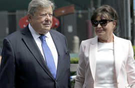 Viktor and Amalija Knavs listen as their attorney makes a statement in New York, Aug. 9, 2018. First lady Melania Trump's parents have been sworn in as U.S. citizens. A lawyer for the Knavses says the Slovenian couple took the citizenship oath on Thu