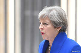FILE - Britain's Prime Minister Theresa May makes a statement in Downing Street after traveling to Buckingham Palace to ask the Queen's permission to form a minority government, in London, June 9, 2017.