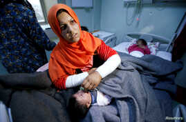 A mother reacts as her daughter Ranmea is treated for possible exposure to chemical weapons agents in a hospital west of Erbil in Mosul, Iraq, March 4, 2017.