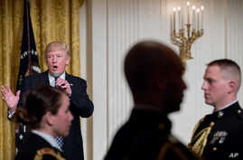 President Donald Trump speaks at a reception for senators and their spouses in the East Room of the White House, in Washington, March 28, 2017.