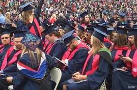 Some of the six thousand Liberty University graduates are seen in the school's football stadium for the Christian university's 44th commencement, in Lynchburg, Virginia, May 13, 2017. President Donald Trump will be speaking at the event. (C. Presutti