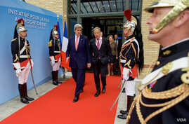 U.S. Secretary of State John Kerry, left, walks with Special Envoy for Israeli-Palestinian Negotiations Frank Lowenstein as they exit the MFA Convention Center in Paris, France, following a French-sponsored conference focused on Middle East peace eff