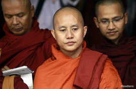 Buddhist monk Wirathu (C), leader of the 969 movement, greets other monks as he attends a meeting on the National Protection Law at a monastery outside Yangon, June 27, 2013.