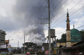 Some rises from houses following airstrikes by Philippine Air Force bombers in Marawi, southern Philippines, May 27, 2017.