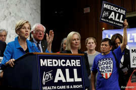 """FILE - Senator Elizabeth Warren (D-MA) speaks during an event to introduce the """"Medicare for All Act of 2017"""" on Capitol Hill in Washington, Sept. 13, 2017."""