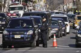 Police direct cars to gas pumps outside a gas station in the Brooklyn borough of New York, November 9, 2012.