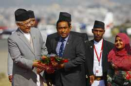 FILE - Maldives President Abdullah Yameen, center, is welcomed at Tribhuwan Airport to attend the South Asian Association for Regional Cooperation summit in Katmandu, Nepal, Nov. 25, 2014.