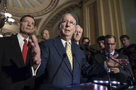 Senate Majority Leader Mitch McConnell, R-Ky., joined by, from left, Sen. John Barrasso, R-Wyo., Sen. John Thune, R-S.D., and Majority Whip John Cornyn, R-Texas, meets with reporters following a closed-door strategy session, at the Capitol in Washing