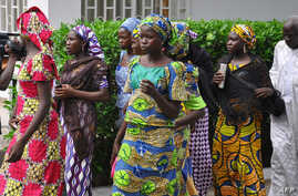 Schoolgirls, who escaped from Boko Haram kidnappers in the village of Chibok, arrive at the Government house to speak with State Governor Kashim Shettima, in Maiduguri, Nigeria, June 2, 2014.
