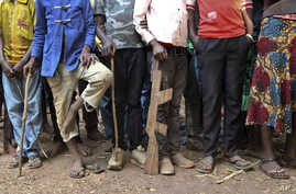 FILE - Former child soldiers stand in line for registration with UNICEF to receive a release package in Yambio, South Sudan, Feb. 7, 2018.