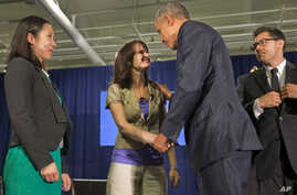 President Barack Obama thanks Crystal Oertle of Shelby, Ohio, for sharing her story of recovery from addiction after they spoke on a panel with others during the National Rx Drug Abuse and Heroin Summit in Atlanta, March 29, 2016.