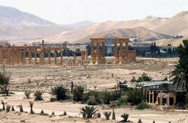FILE - This file photo released on Sunday, May 17, 2015, by the Syrian official news agency SANA, shows the general view of the ancient Roman city of Palmyra, northeast of Damascus, Syria.