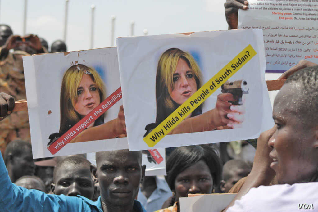 A protester holds up an sign against UNMISS head Hilde Johnson at a peace rally in Juba.