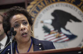 U.S. Attorney General Loretta Lynch announces an indictment against nine FIFA officials and five corporate executives for racketeering, conspiracy and corruption at a news conference, May 27, 2015, in the Brooklyn borough of New York.