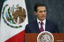 Mexico's President Enrique Pena Nieto talks during an official swearing-in ceremony for new ministers at the Los Pinos official residence in Mexico City, Aug. 27, 2015.