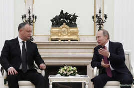 Russian President Vladimir Putin, right, meets with his Moldovan counterpart, Igor Dodon, at the Kremlin in Moscow, Jan. 17, 2017.