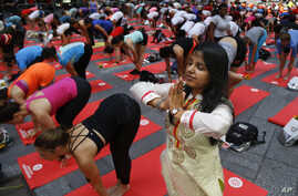 Deepika Agarwal, of Jaipur, India, practices yoga during the 13th annual Solstice in Times Square event, June 21, 2015, in New York.