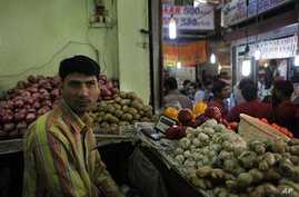 A vegetable seller, Vijay Kumar, waits for customers in his shop in an upscale INA market, in New Delhi, India (File Photo)