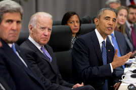 President Barack Obama, accompanied by, from left,  Secretary of State John Kerry, Vice President Joe Biden, and National Security Adviser Susan Rice, speaks during a meeting with Chinese President Xi Jinping at the Nuclear Security Summit in Washing