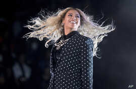 FILE -  Beyonce performs at a Get Out the Vote concert for Democratic presidential candidate Hillary Clinton in Cleveland.