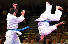 Turkey's team competes in the third-place fight at the Men's Kata Team competition at the 22nd Karate World Championships in Bremen, Germany, Monday.