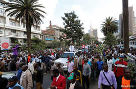 Kenyan opposition leader of the Coalition for Reforms and Democracy (CORD), Raila Odinga (C) leads his supporters during a protest near the premises hosting the headquarters of Independent Electoral and Boundaries Commission (IEBC) to demand the disb