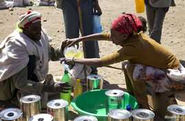 A man receives cooking oil at an emergency food aid distribution center in the village of Estayish in Ethiopia's northern Amhara region, Feb. 11, 2016.